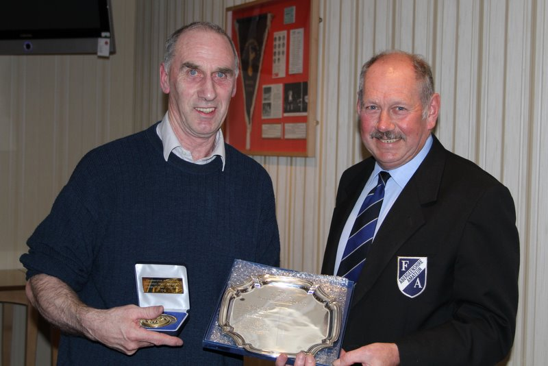 Jim Napier presents the Association Medal for 2010 to George Matthews of Alford