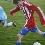 Fraser Thomson on his way to scoring a terrific third goal for his team after beating four players.